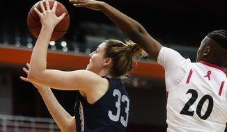 Connecticut's Katie Lou Samuelson (33) shoots against Cincinnati's Maya Benham (20) during the first half of an NCAA college basketball game Tuesday, Feb. 7, 2017, in Cincinnati. (AP Photo/John Minchillo)
