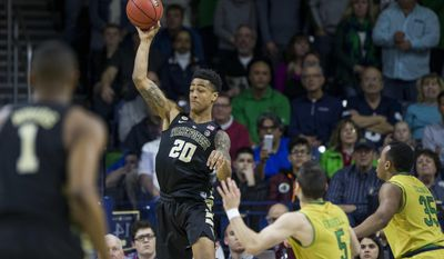 Wake Forest's John Collins (20) passes the ball away next to Notre Dame's Matt Farrell (5) and Bonzie Colson (35) during the first half of an NCAA college basketball game Tuesday, Feb. 7, 2017, in South Bend, Ind. Notre Dame defeated Wake Forest 88-81.(AP Photo/Robert Franklin)