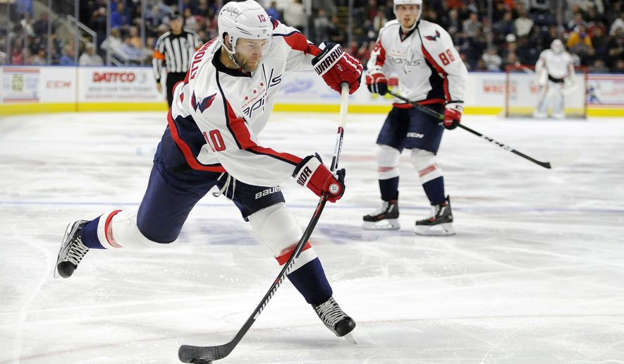 FILE - In this Oct. 1, 2016, file photo, Washington Capitals' Brett Connolly shoots during the second period of a preseason NHL hockey game against the New York Islanders in Bridgeport, Conn. Once a highly-touted top-10 draft pick who didn't live up to expectations, Connolly has revitalized his career after signing at a bargain-basement price with the Capitals. (AP Photo/Jessica Hill, File)