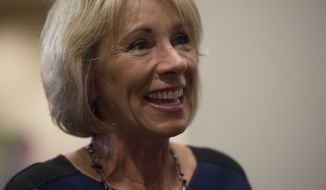 Education Secretary Betsy DeVos smiles while greeting employees after addressing the department staff at the Department of Education on Wednesday, Feb. 8, 2017 in Washington. (AP Photo/Molly Riley)