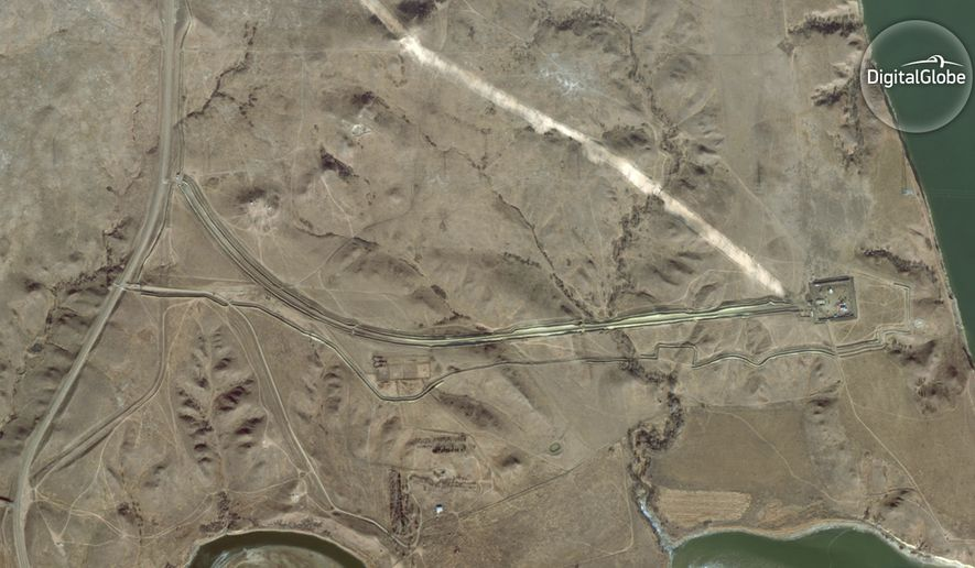FILE - This Nov. 25, 2016, file satellite image taken by DigitalGlobe shows the construction site of the Dakota Access pipeline along the Missouri River, at right, near Cannon Ball, N.D. Opponents of the pipeline called for protests around the world Wednesday, Feb. 8, 2017, as the Army prepared to greenlight the final stage of the $3.8 billion project's construction. The Army said Tuesday, Feb. 7, that it will allow the four-state pipeline to cross under a Missouri River reservoir in North Dakota, the last big chunk of construction. (DigitalGlobe via AP, File)