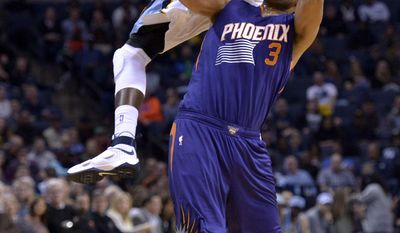 Memphis Grizzlies forward JaMychal Green, top, collides with Phoenix Suns forward Jared Dudley (3) in the first half of an NBA basketball game Wednesday, Feb. 8, 2017, in Memphis, Tenn. (AP Photo/Brandon Dill)