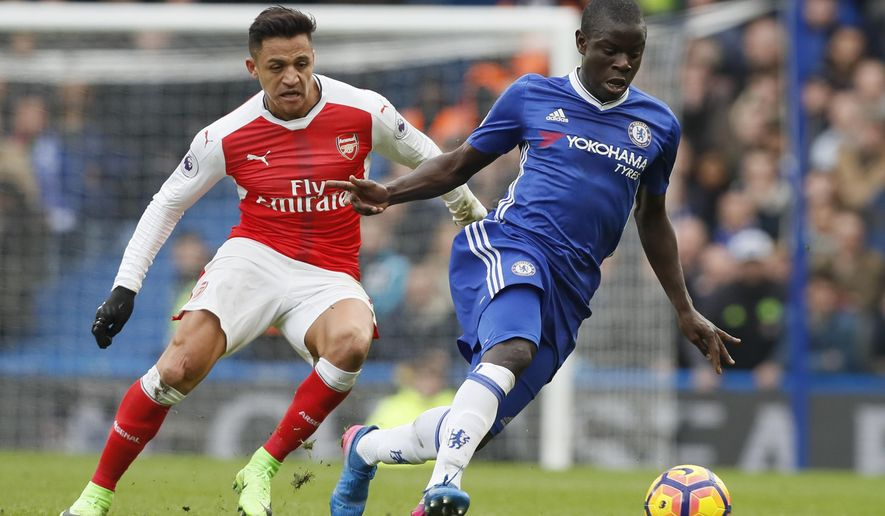 Chelsea's N'Golo Kante, right holds off the challenge of Arsenal's Alexis Sanchez during the English Premier League soccer match between Chelsea and Arsenal at Stamford Bridge stadium in London, Saturday, Feb. 4, 2017. (AP Photo/Kirsty Wigglesworth)