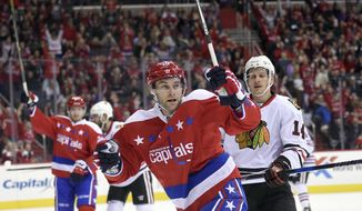 FILE - In this Jan. 13, 2017, file photo, Washington Capitals right wing Brett Connolly (10) celebrates after scoring against the Chicago Blackhawks during the first period of an NHL hockey game in Washington. Once a highly-touted top-10 draft pick who didn't live up to expectations, Connolly has revitalized his career after signing at a bargain-basement price with the Capitals. (AP Photo/Nick Wass, File)