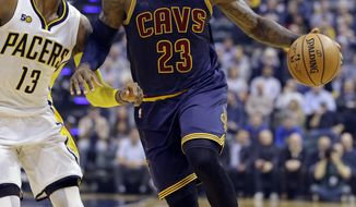 Cleveland Cavaliers forward LeBron James (23) drives on Indiana Pacers forward Paul George (13) during the first half of an NBA basketball game in Indianapolis, Wednesday, Feb. 8, 2017. (AP Photo/Michael Conroy)