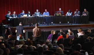 Council members listen to public comment at the Jackson City Council meeting held at the Michigan Theatre,  Tuesday, Feb. 7, 2017, in Jackson, Mich. The council was hearing comment and voting on a a proposed non-discrimination ordinance. (J. Scott Park/Jackson Citizen Patriot via AP)