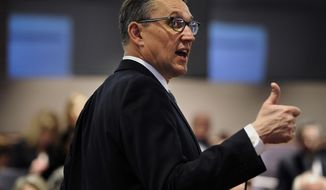 Office of Policy and Management Secretary Ben Barnes holds a presentation on Connecticut Gov. Dannel P. Malloy's budget proposal for members of the media at the Legislative Office Building in Hartford, Conn., Wednesday, Feb. 8, 2017.  (AP Photo/Jessica Hill)