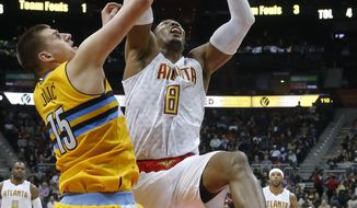 CORRECTS DENVER PLAYER TO JOKIC INSTEAD OF FARIED - Atlanta Hawks center Dwight Howard (8) battles Denver Nuggets forward Nikola Jokic (15) for a rebound during the first half of an NBA basketball game Wednesday, Feb. 8, 2017, in Atlanta. (AP Photo/John Bazemore)