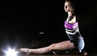 ADVANCE FOR FEB. 13, 2017- Byron, Minn., gymnast Hannah Coleman is a star in that sport as well as track and field. The senior's coach in each is her father, Charro Coleman. (Andrew Link/The Rochester Post-Bulletin via AP)