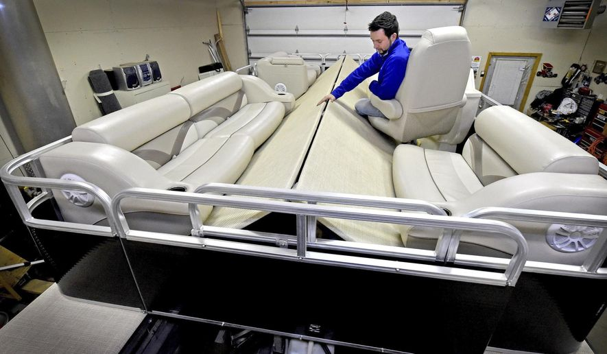 ADVANCE FOR WEEKEND OF FEB. 11, 2017- Jeremy Little shows his folding, collapsible pontoon boat in Oakdale, Minn. on Thursday, Jan. 26, 2017. Little, 33, a student in an entrepreneurship program at the University of St. Thomas, is marketing the pontoon boat that his father, now deceased, invented. (Jean Pieri/Pioneer Press via AP)