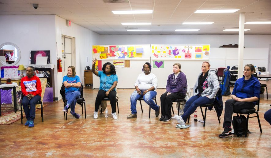 "Women participate in a group session at the Austin Street Center's women's day resource program called ""The Sisterhood"" on Jan. 17, 2017 in Dallas. The program addresses the challenges of homeless women.   (Ashley Landis/The Dallas Morning News via AP)"