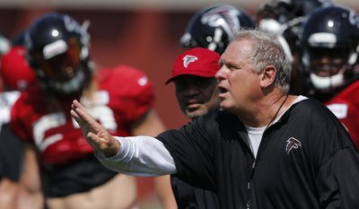 FILE - In this Aug. 2, 2016, file photo, Atlanta Falcons defensive coordinator Richard Smith signals to his players during an NFL football practice in Flowery Branch, Ga. After squandering a 25-point lead in the Super Bowl, the Falcons are shaking up their defensive staff. The team said Wednesday, Feb. 8, 2017, that coach Dan Quinn has dismissed coordinator Richard Smith and defensive line coach Bryan Cox, though there's a chance Smith could stay with the Falcons in an advisory role.  (AP Photo/John Bazemore, File)
