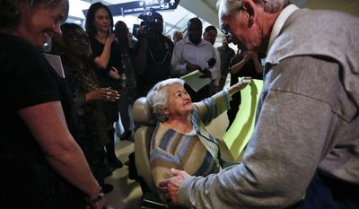 Former Alabama Gov. Don Siegelman, right, greets his mother-in-law Evelyn Allen as he arrives at the Birmingham-Shuttlesworth International Airport, Wednesday, Feb. 8, 2017, in Birmingham, Ala. Siegelman was released Wednesday from a federal prison in Louisiana where he was serving a six-year sentence for bribery and obstruction of justice, a family spokesman said.(AP Photo/Brynn Anderson)
