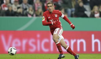 Bayern's Philipp Lahm controls the ball during the German Soccer Cup match between FC Bayern Munich and VfL Wolfsburg at the Allianz Arena stadium in Munich, Germany, Tuesday, Feb. 7, 2017. (AP Photo/Matthias Schrader)