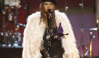 "FILE - This June 26, 2016 file photo shows Erykah Badu performing ""The Ballad of Dorothy Parker"" during a tribute to Prince at the BET Awards in Los Angeles. (Photo by Matt Sayles/Invision/AP, File)"