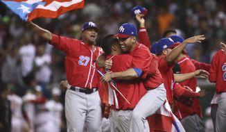 Puerto Rico's Criollos de Caguas players celebrate after the team won the Caribbean Series baseball championship title game, 1-0 over Mexico's Aguilas de Mexicali in Culiacan, Mexico, Tuesday, Feb. 7, 2017. (AP Photo/Luis Gutierrez)