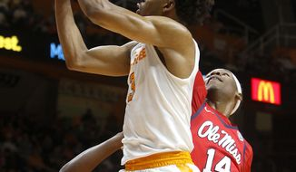 Tennessee's Robert Hubbs III (3) goes for a layup against Mississippi's Rasheed Brooks (14) during an NCAA college basketball game in Knoxville, Tenn., Wednesday, Feb. 8, 2017. (Daryl Sullivan/The Daily Times via AP)