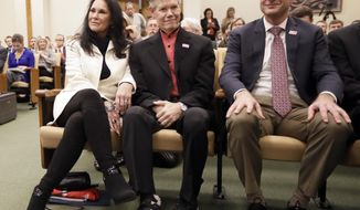 Country singer Randy Travis, center, sits with his wife, Mary, left, and Dr. Blaise Baxter, right, of Erlanger Hospital in Chattanooga, Tenn., before a meeting of the Senate Health and Welfare Committee on Wednesday, Feb. 8, 2017, in Nashville, Tenn. Randy Travis, who suffered a stroke in 2013, attended the hearing for Stroke Awareness Day at the legislature. Dozens of country stars, from Garth Brooks to Kenny Rogers, are scheduled to perform at a tribute show Wednesday night in Nashville to honor Travis. (AP Photo/Mark Humphrey)
