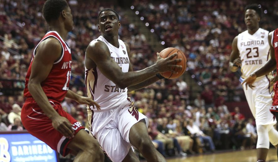 Florida State's Dwayne Bacon drives into the lane against North Carolina State's Cameron Gottfried during an NCAA college basketball game Wednesday, Feb. 8, 2017., in Tallahassee, Fla. (Joe Rondone/Tallahassee Democrat via AP)
