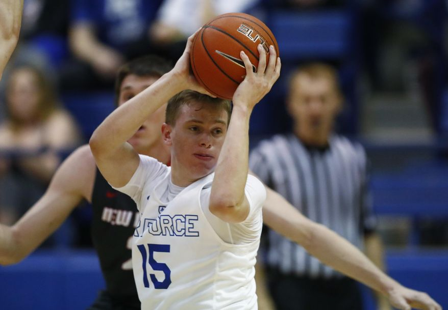 Air Force guard Jacob Van, front, looks to pass the ball as New Mexico forward Joe Furstinger defends late in the first half of an NCAA college basketball game Wednesday, Feb. 8, 2017, at Air Force Academy, Colo. (AP Photo/David Zalubowski)