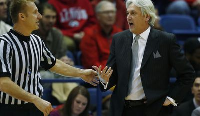 New Mexico head coach Craig Neal, right, argues a call with a referee while facing Air Force in the first half of an NCAA college basketball game, Wednesday, Feb. 8, 2017, at Air Force Academy, Colo. (AP Photo/David Zalubowski)