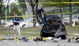 FILE - In this May 4, 2015 file photo, FBI crime scene investigators document evidence outside the Curtis Culwell Center in Garland, Texas. Sentencing is set Wednesday, Feb. 8, 2017, for American-born Muslim convert Abdul Malik Abdul Kareem, who was convicted of helping to plot a 2015 attack on a Prophet Muhammad cartoon contest in Texas. (AP Photo/Brandon Wade, File)