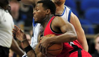 Minnesota Timberwolves guard Tyus Jones, back, defends against Toronto Raptors guard Kyle Lowry during the first quarter of an NBA basketball game on Wednesday, Feb. 8, 2017, in Minneapolis. (AP Photo/Hannah Foslien)
