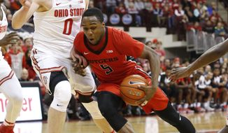 Rutgers' Mike Williams, right, drives the lane against Ohio State's Micah Potter during the first half of an NCAA college basketball game Wednesday, Feb. 8, 2017, in Columbus, Ohio. (AP Photo/Jay LaPrete)