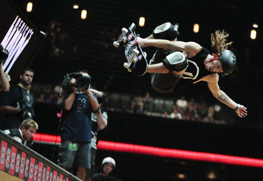 FILE - In this July 30, 2011, file photo, Shaun White competes during the Skateboard Vert final at the X Games in Los Angeles. The next Olympics are still a year away, and already, Shaun White is thinking about the games after that. The Summer Games, that is. The world's best-known snowboarder tells The Associated Press he's exploring competing in Tokyo in skateboarding, which will be added to the program for 2020.  (AP Photo/Bret Hartman, File)