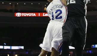 San Antonio Spurs' LaMarcus Aldridge, right, goes up for a shot against Philadelphia 76ers' Gerald Henderson during the first half of an NBA basketball game, Wednesday, Feb. 8, 2017, in Philadelphia. (AP Photo/Matt Slocum)