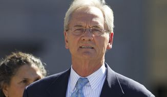 FILE - In this Nov. 2, 2011 file photo, former Alabama Gov. Don Siegelman departs the Federal courthouse in Montgomery, Ala. Siegelman was released Wednesday, Feb. 8, 2017, from a federal prison in Louisiana where he was serving a six-year sentence for bribery and obstruction of justice, a family spokesman said.  (AP Photo/Dave Martin, File)
