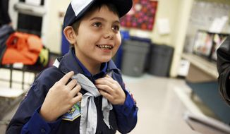 "In this Feb. 7, 2017 photo, Joe Maldonado, the first openly transgender member of the Boy Scouts, shows off the uniform he received from Scout leader Kyle Hackler to wear to his first meeting in Maplewood, N.J. Boy Scouts of America recently changed its policy to allow transgender children to join the organization. ""I am accepted,"" Maldonado said as he put on the uniform. (Amy Newman/The Record via AP)"