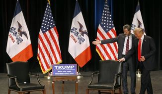 FILE - In this Sunday, Jan. 31, 2016 file photo, Jerry Falwell, Jr., left, president of Liberty University, guides Republican presidential candidate Donald Trump to his seat during a campaign event at the Orpheum Theatre in Sioux City, Iowa. Mixed signals from the White House on gay rights and conscience protections have put two constituencies on edge: LGBT advocates already wary of President Donald Trump and religious conservatives determined to hold him to his campaign promises. (AP Photo/Patrick Semansky)