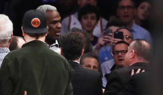 Former New York Knick Charles Oakley was arrested during the team's game on Wednesday after shoving security guards and shouting at team owner James Dolan. (Associated Press)