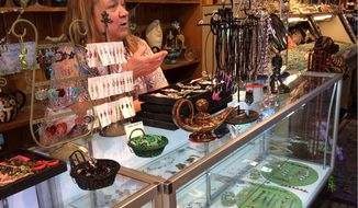 Sally Tennant, owner of Discoveries gift shop, reopened her formerly flooded Ellicott City shop in November, a feat she said would not have been possible were it not for volunteers and neighbors who pitched in to help. (Photographs by Julia Brouillette/The Washington Times)