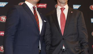 San Francisco 49ers head coach Kyle Shanahan, right, and general manager John Lynch pose for photos during an NFL football press conference Thursday, Feb. 9, 2017, in Santa Clara, Calif. (AP Photo/Marcio Jose Sanchez)