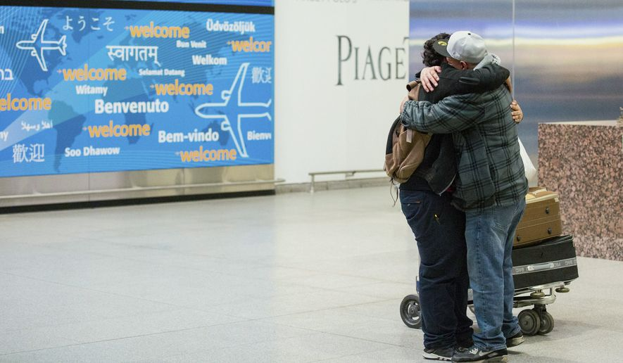 Travelers from the seven predominantly Muslim countries affected by President Donald Trump's ban enjoyed tearful reunions with family members in the U.S. after a federal judge swept the restrictions aside. (AP Photo/Alexander F. Yuan)
