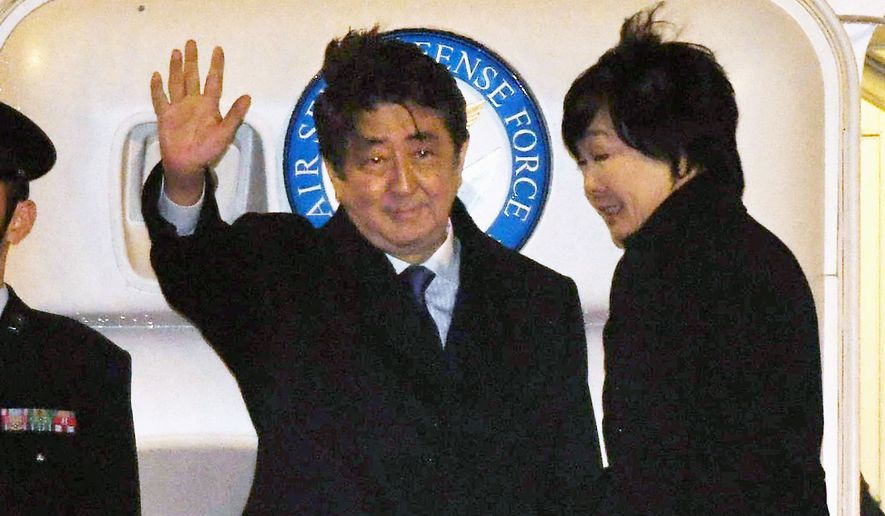 Japanese Prime Minister Shinzo Abe, accompanied by his wife, Akie, departs from Toyko to meet President Trump in Washington on Friday. (Associated Press)