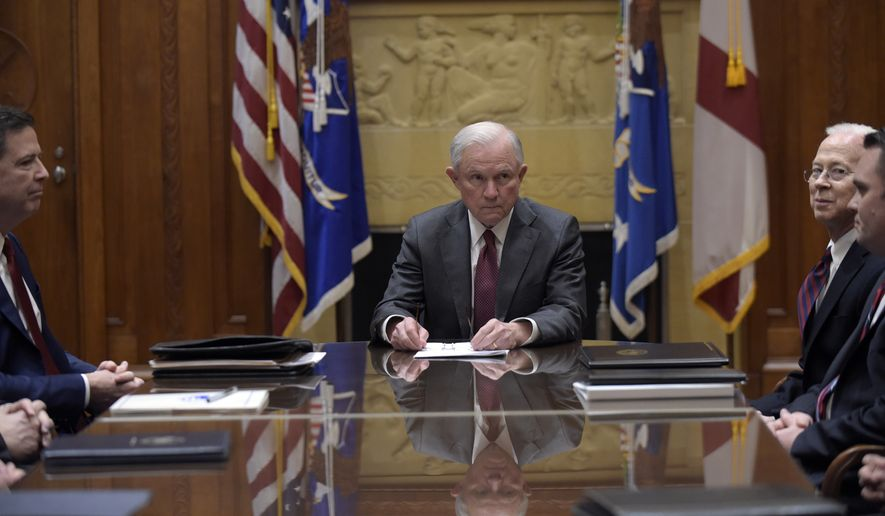 Attorney General Jeff Sessions, center, holds a meeting with the heads of federal law enforcement components at the Department of Justice in Washington, Thursday, Feb. 9, 2017. FBI Director James Comey sits at left and Acting Deputy Attorney General Dana Boente is at right. (AP Photo/Susan Walsh, Pool)