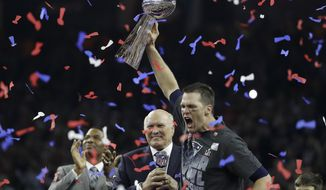 New England Patriots' Tom Brady, right, celebrates with the Vince Lombardi Trophy next to broadcasters Terry Bradshaw, center, and Michael Strahan after the NFL Super Bowl 51 football game against the Atlanta Falcons Sunday, Feb. 5, 2017, in Houston. (AP Photo/Elise Amendola)