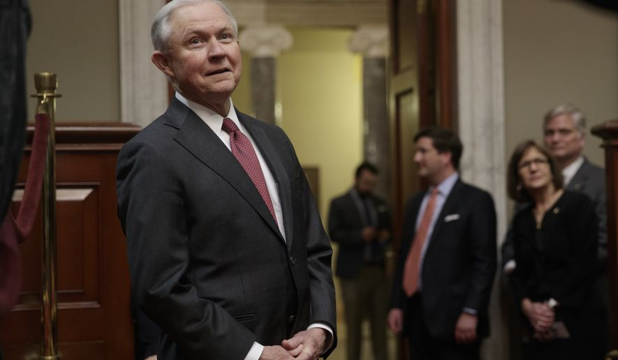 New Attorney General Jeff Sessions watches from the background as his Senate replacement Sen. Luther Strange, R-Ala. is welcomed at a ceremony on Capitol Hill in Washington, Thursday, Feb. 9, 2017. (AP Photo/J. Scott Applewhite)