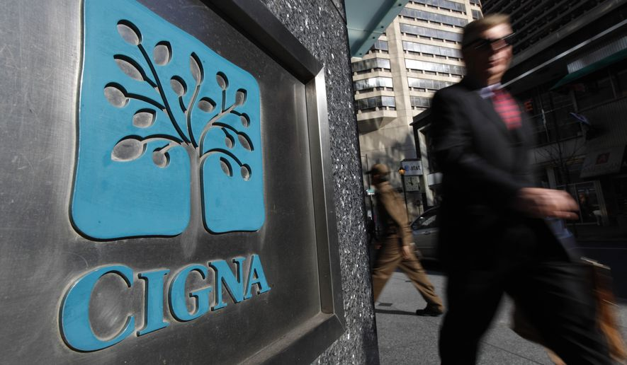 FILE - In this Nov. 17, 2009 file photo, a pedestrian walks past the headquarters of the health insurer Cigna Corp. in in Philadelphia. A federal judge on Wednesday, Feb. 8, 2017, rejected Anthem Inc.'s bid to buy rival health insurer Cigna Corp., saying the merger would likely lead to higher costs, less competition and diminished innovation. U.S. District Judge Amy Berman Jackson said the merger would significantly reduce competition in the already concentrated insurance market, particularly for large national employers. (AP Photo/Matt Rourke, File)