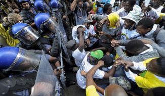Protesters clash with police near parliament in Cape Town, South Africa, Thursday, Feb. 9, 2017 prior to it's opening and a national address by President Jacob Zuma. Hundreds of armed forces have been deployed in the city to increase security as opposition groups denounce Zuma, saying he should resign because of corruption allegations against him. (AP Photo)