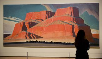 "In this Monday, Feb. 6, 2017 photo, Maynard Dixon's 1935 painting ""Red Butte with Mountain Men"" is displayed in the exhibit ""Cross Country: The Power of Place in American Art, 1915-1950,"" at the High Museum of Art in Atlanta. The new exhibition at takes a look at how American artists during the modernist period traveled outside cities to find inspiration in the rural landscape. (AP Photo/David Goldman)"