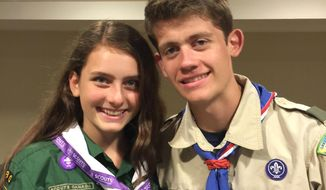 This June 2016 provided by their father, Gary Ireland, shows 15-year-old Sydney Ireland, left, of New York, with her bother, Bryan, who is an Eagle Scout, at a National Organization for Women conference in Washington. For several years, Sydney has been an unofficial member of her brother's troop in Manhattan, participating in many of its activities but unable to earn merit badges to start on the path to Eagle rank. (Gary Ireland via AP)