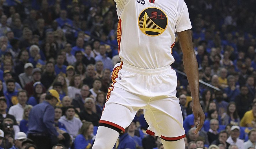 Golden State Warriors forward Kevin Durant lays up a shot against the Chicago Bulls during the first half of an NBA basketball game Wednesday, Feb. 8, 2017, in Oakland, Calif. (AP Photo/Ben Margot)