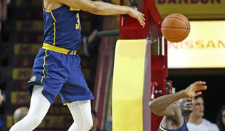 California's Stephen Domingo, left, blocks the shot of Arizona State guard Tra Holder (0) as California's guard Jabari Bird, right, watches during the first half of an NCAA college basketball game Wednesday, Feb. 8, 2017, in Tempe, Ariz. (AP Photo/Ross D. Franklin)