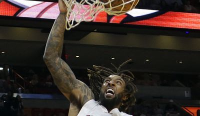 FILE - In this Feb. 4, 2017, file photo, Miami Heat forward Derrick Williams (22) dunks against the Philadelphia 76ers in the second half of an NBA basketball game in Miami. The Cavaliers intend to sign forward Derrick Williams to a 10-day contract. Williams, the No. 2 overall pick in the 2011 draft, is traveling to Oklahoma City and the NBA champions hope to sign him before they face the Thunder on Thursday night. Williams was recently released by the Miami Heat after averaging 5.9 points in 25 games.(AP Photo/Alan Diaz, File)