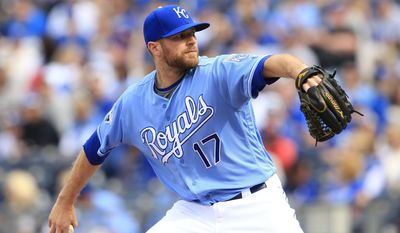 FILE - In this April 10, 2016, file photo, Kansas City Royals relief pitcher Wade Davis throws during a baseball game against the Minnesota Twins at Kauffman Stadium in Kansas City, Mo. Davis is expected to take over as the Chicago Cubs closer for Aroldis Chapman, who returned to the New York Yankees for an $86 million, five-year contract during free agency. Davis was acquired by the Cubs in a December trade with Kansas City for outfielder Jorge Soler.  (AP Photo/Orlin Wagner, File)