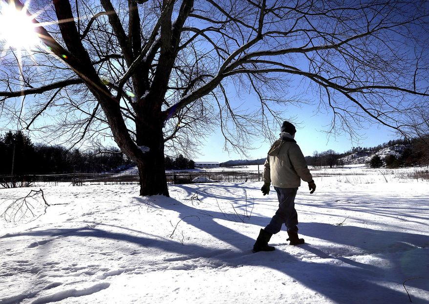 In this Feb. 3 2017 photo, Ron Baerbock walks his 10-acre homestead in rural Merrillan, Wis. His property is adjacent to land where proposed frack sand mines and processing facilities might be built. According to complaints filed in Jackson County Circuit Court, two proposed mines with processing and loading facilities would infringe on the rights of six families who live on or own neighboring properties. (Peter Thomson/La Crosse Tribune/La Crosse Tribune via AP)